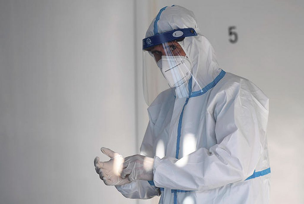 Health worker wearing overalls and protective mask performs rapid antigen tests for COVID-19 in a medical office, Rome, Italy, 17 November 2020. Italy fights with the second wave of pandemic of the SARS-CoV-2 coronavirus which causes the Covid-19 disease.   ANSA / ETTORE FERRARI