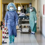 Health workers wearing overalls and protective masks in the intensive care unit of the Tor Vergata hospital during the second wave of the Covid-19 Coronavirus pandemic, Rome, Italy, 26 November 2020.  ANSA/GIUSEPPE LAMI