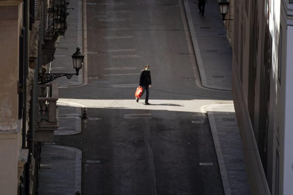 A man walks in deerted central Condotti road in Rome, Italy 16 March 2020.  Italy is under lockdown in an attempt to prevent the spread of the pandemic Coronavirus. Several European countries have closed borders, schools as well as public facilities, and have cancelled most major sports and entertainment events in order to prevent the spread of the SARS-CoV-2 Coronavirus causing the Covid-19 disease. ANSA/MASSIMO PERCOSSI